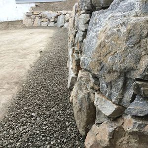 Retaining and natural rock wall installation